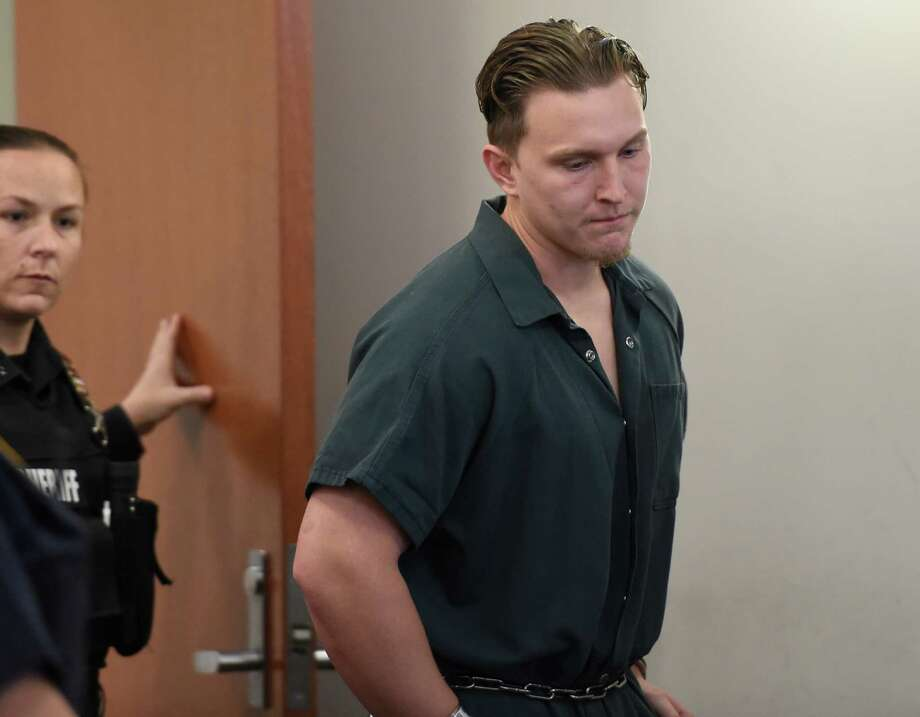 Shane Harding is lead in to Troy City Court for his arraignment on multiple charges Thursday morning Oct. 16, 2014  in Troy, N.Y.     (Skip Dickstein/Times Union) Photo: SKIP DICKSTEIN / 10029048A