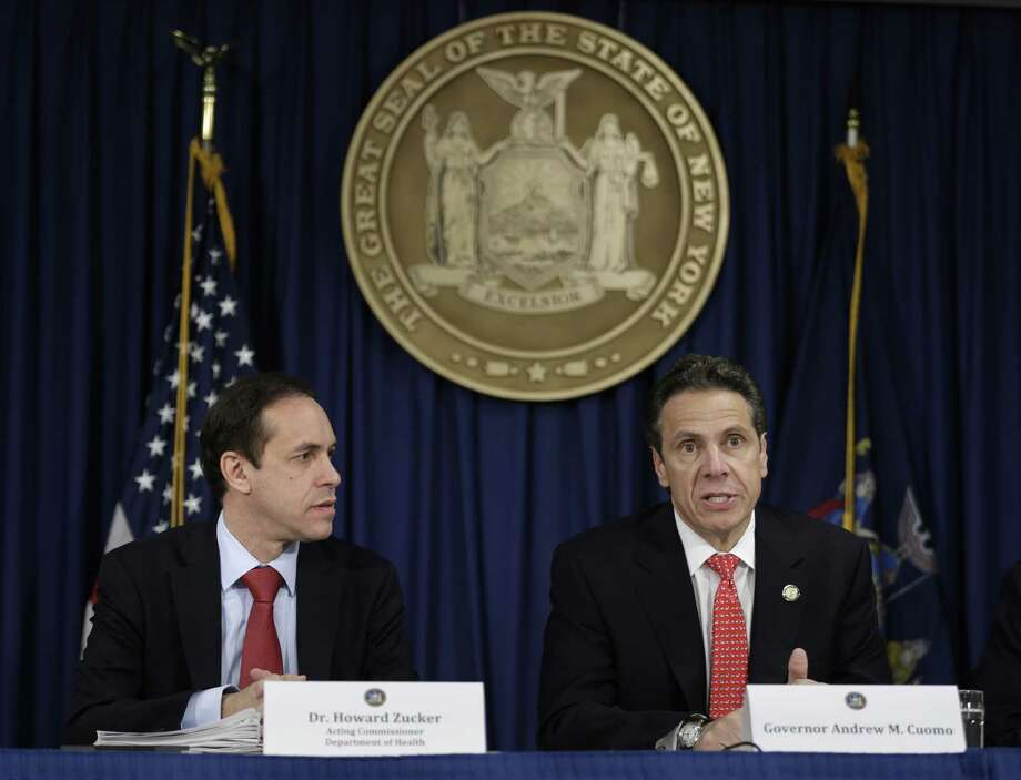 New York governor Andrew Cuomo, right,  speaks while the acting Commissioner of the Department of Health Howard Zucker listens during a news conference in New York, Thursday, Oct. 16, 2014. Cuomo said that eight hospitals across the state are especially prepared with go-to teams who've been drilled in anti-Ebola protocols. In addition, officials said public transportation systems including New York City's subways and buses are on the alert for possible passengers carrying the virus. (AP Photo/Seth Wenig)  ORG XMIT: NYSW103 Photo: Seth Wenig / AP