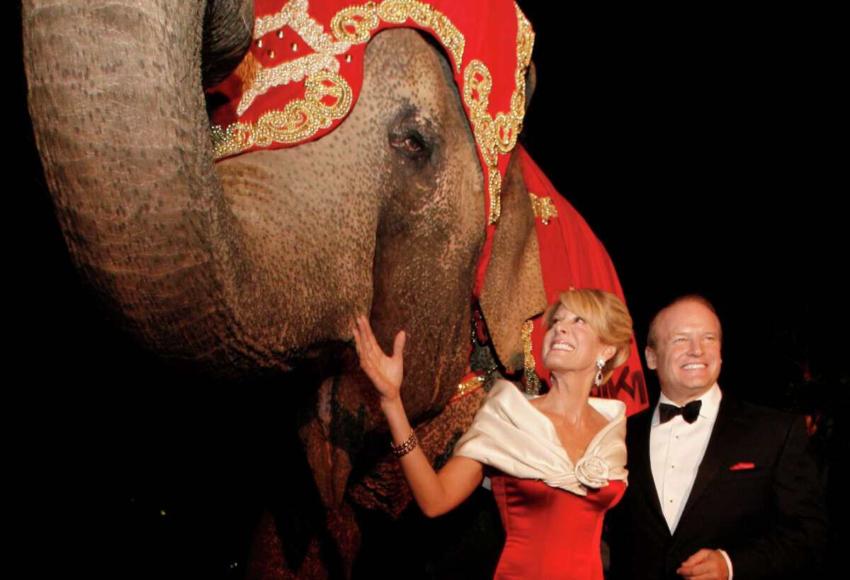 """Jillian Manus and then-husband Alan Salzman at their """"Politically Incorrect"""" charity ball for the Stanford Comprehensive Cancer Center in 2008. Guests arriving at the door were startled to learn they could have commemorative photos taken with a live elephant."""