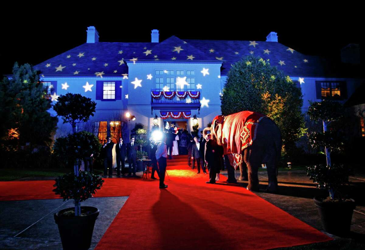 """In 2008, the home of Atherton literary agent Jillian Manus and venture capitalist Alan Salzman was the venue for a $1,000 a person fundraiser for the Stanford Cancer Center. The """"Politically Incorrect"""" theme was displayed outside with red, white and blue lighting - and a live elephant (a symbol of the Republican party.) Photo by Kim Komenich/The Chronicle"""