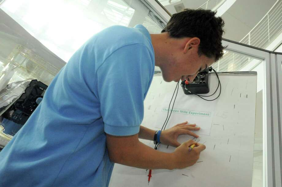Southern Adirondack BOCES student Ethan Pike takes part in a electrical conductivity expewriment during a NanoCareer Day at Albany NanoTech in Albany on Thursday Oct. 16, 2014 in Watervliet, N.Y.  (Michael P. Farrell/Times Union) Photo: Michael P. Farrell / 00029057A