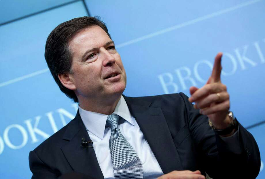 """FBI Director James Comey speaks about the impact of technology on law enforcement, Thursday, Oct. 16, 2014, at Brookings Institution in Washington. Comey gave a stark warning Thursday against smartphone data encryption, saying homicide cases could be stalled, suspects could go free and """"justice may be denied because of a locked phone or an encrypted hard drive.""""  (AP Photo/Jose Luis Magana) ORG XMIT: DCJL104 Photo: Jose Luis Magana / FR159526 AP"""