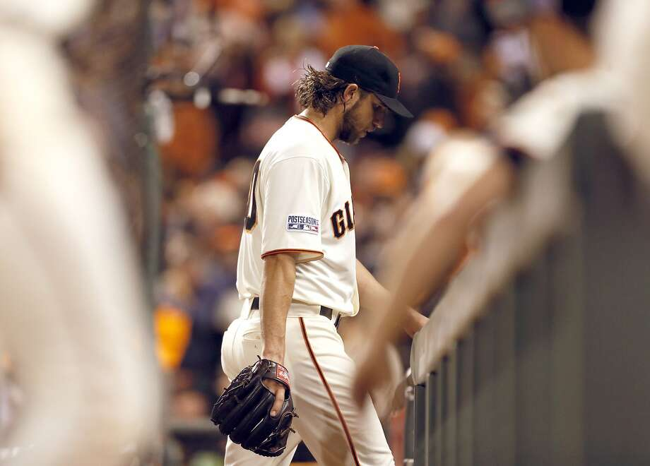 Giants Madison Bumgarner walks back to the dugout after the sixth inning during Game 5 of the NLCS at AT&T Park on Thursday, Oct. 16, 2014 in San Francisco, Calif. Photo: Beck Diefenbach, Special To The Chronicle