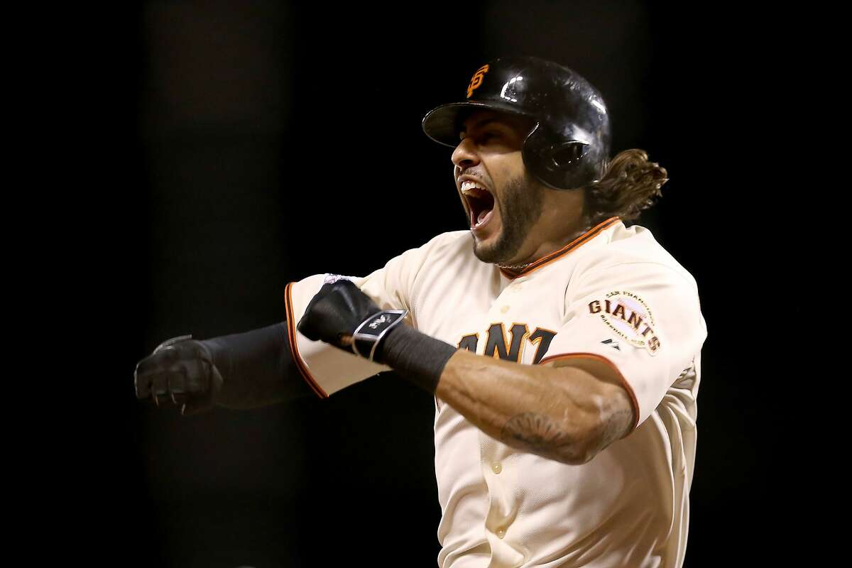 SAN FRANCISCO, CA - OCTOBER 16: Michael Morse #38 of the San Francisco Giants celebrates after hitting a solo home run in the eighth inning against the St. Louis Cardinals during Game Five of the National League Championship Series at AT&T Park on October 16, 2014 in San Francisco, California. (Photo by Christian Petersen/Getty Images)