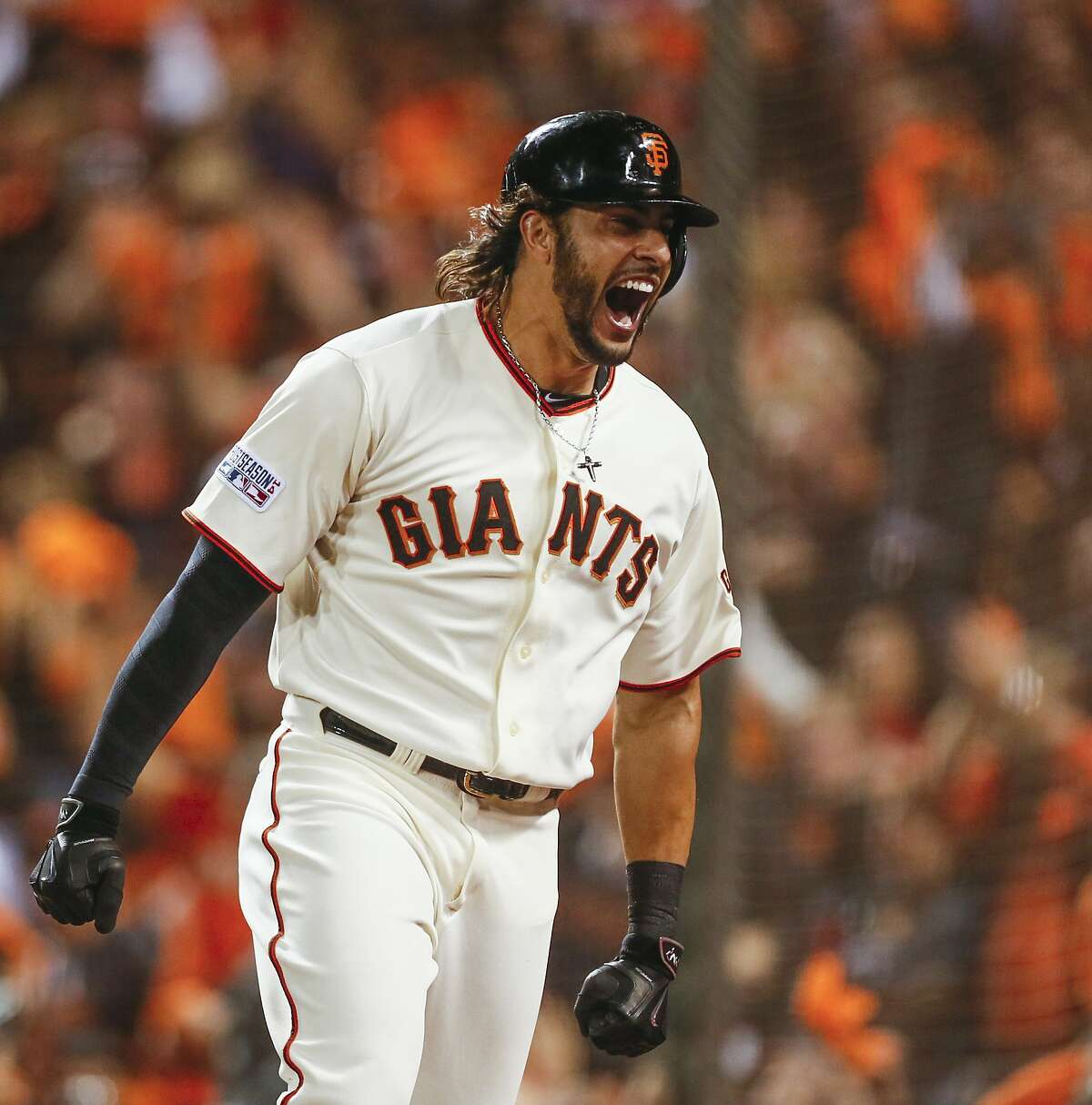 Giants Michael Morse celebrates a solo homer in the eighth inning during Game 5 of the NLCS at AT&T Park on Thursday, Oct. 16, 2014 in San Francisco, Calif.