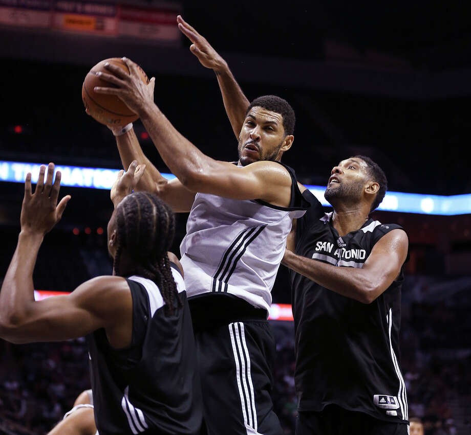 San Antonio Spurs Jeff Ayers grabs a rebound against Tim Duncan during an open scrimmage at the AT&T Center, Wednesday, Oct. 1, 2014. Photo: JERRY LARA, San Antonio Express-News / © 2014 San Antonio Express-News