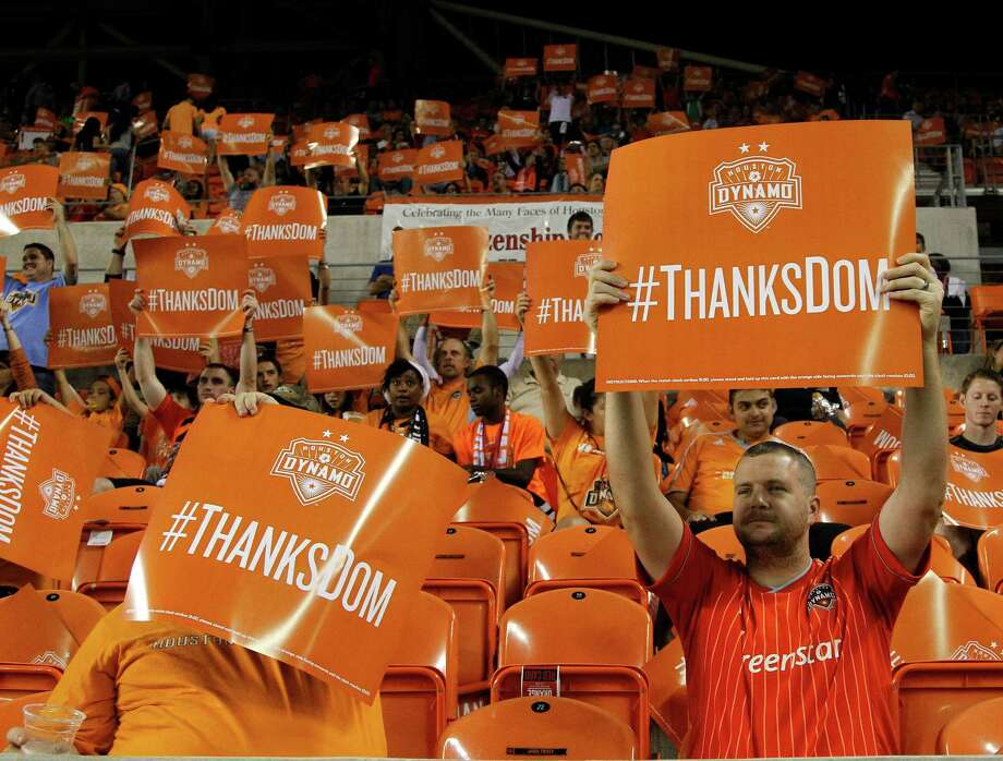 """Houston Dynamo fans hold up """"Thanks Dom"""" signs at the nine-minute mark during the first half of an MLS soccer match at BBVA Compass Stadium, Thursday, Oct. 16, 2014, in Houston. Photo: Karen Warren, Houston Chronicle / © 2014 Houston Chronicle"""