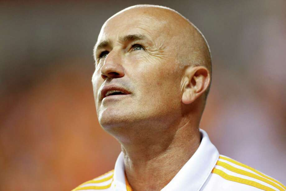 Houston Dynamo's head coach Dominic Kinnear during the National Anthem before the start of an MLS soccer match at BBVA Compass Stadium, Thursday, Oct. 16, 2014, in Houston. Photo: Karen Warren, Houston Chronicle / © 2014 Houston Chronicle
