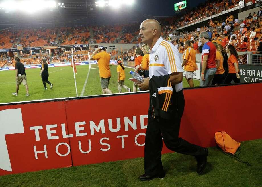 Houston Dynamo's head coach Dominic Kinnear walks out on the field before the start of an MLS soccer match at BBVA Compass Stadium, Thursday, Oct. 16, 2014, in Houston. Photo: Karen Warren, Houston Chronicle / © 2014 Houston Chronicle