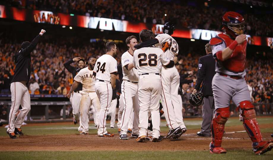 The Giants celebrate their 6 to 3 win over the St. Louis Cardinals in Game 5 of the NLCS at AT&T Park on Thursday, Oct. 16, 2014 in San Francisco, Calif. Photo: Michael Macor, The Chronicle