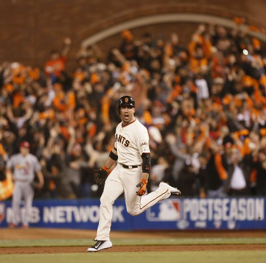 Giants Travis Ishikawa rounds the bases after hitting a three-run homer to defeat the St. Louis Cardinals 6 to 3 sending the Giants to the World Series during Game 5 of the NLCS at AT&T Park on Thursday, Oct. 16, 2014 in San Francisco, Calif. Photo: Beck Diefenbach, Special To The Chronicle