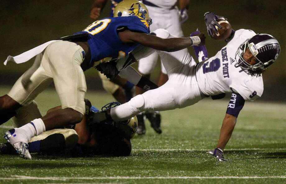 Ridge Point running back Cedric Horton (9) is tackled by Elkins defensive back Kenneth Murray during the second half of a high school football game at Hall stadium on Thursday, Oct. 16, 2014, in Missouri City. Photo: J. Patric Schneider, For The Chronicle / © 2014 Houston Chronicle