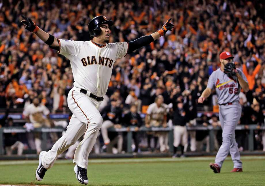Travis Ishikawa is flying high after hitting a walkoff three-run homer in the ninth inning against the Cardinals on Thursday night, lifting the Giants into the World Series for the third time in five years. Photo: David J. Phillip, STF / AP