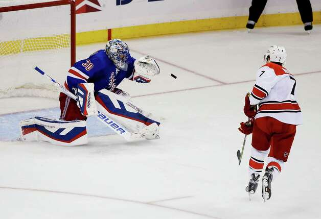 New York Rangers goalie Henrik Lundqvist (30), of Sweden, stops a shot by Carolina Hurricanes' Ryan Murphy (7) during the shootout in an NHL hockey game Thursday, Oct. 16, 2014, in New York. The Rangers won 2-1. (AP Photo/Frank Franklin II) ORG XMIT: MSG113 Photo: Frank Franklin II / AP