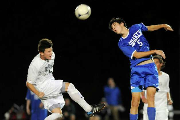 Shen's Miles Burbank, left, and Shaker's Justin Brehm battle for a header during their soccer game on Thursday, Oct. 16, 2014, at Shenendehowa High in Clifton Park, N.Y. (Cindy Schultz / Times Union) Photo: Cindy Schultz / 10029041A
