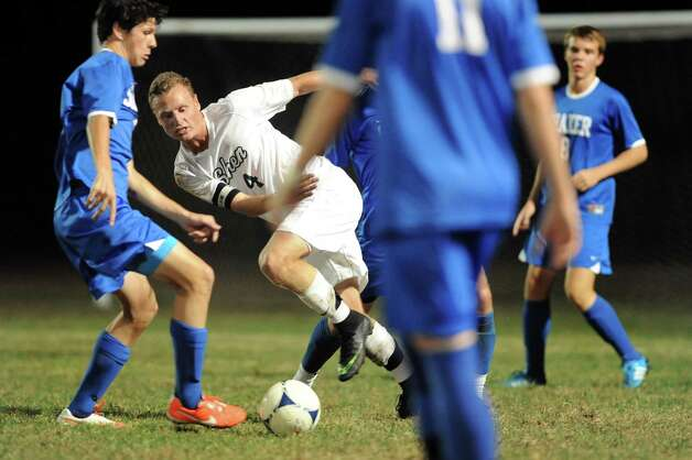 Shen's Tucker Marvin, center, finds himself surrounded by Shaker defenders during their soccer game on Thursday, Oct. 16, 2014, at Shenendehowa High in Clifton Park, N.Y. (Cindy Schultz / Times Union) Photo: Cindy Schultz / 10029041A