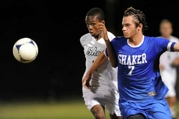 Shaker's Greg Milnarik, right, and Shen's Malik Sykes battle for a loose ball during their soccer game on Thursday, Oct. 16, 2014, at Shenendehowa High in Clifton Park, N.Y. (Cindy Schultz / Times Union) Photo: Cindy Schultz / 10029041A