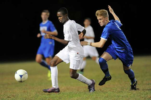 Shen's Malik Sykes, center, controls the ball as Shaker's Tommy Jelstrom defends during their soccer game on Thursday, Oct. 16, 2014, at Shenendehowa High in Clifton Park, N.Y. (Cindy Schultz / Times Union) Photo: Cindy Schultz / 10029041A