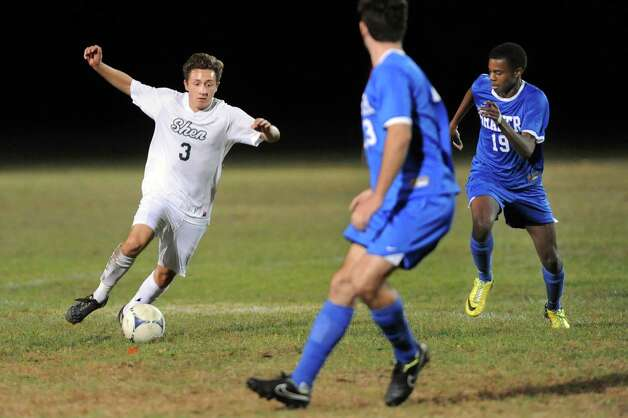 Shen's Michael Miner, left, controls the ball as Shaker's Matt Jeanpierrre, right, moves in to defend during their soccer game on Thursday, Oct. 16, 2014, at Shenendehowa High in Clifton Park, N.Y. (Cindy Schultz / Times Union) Photo: Cindy Schultz / 10029041A