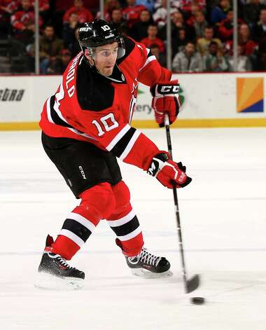 NEWARK, NJ - NOVEMBER 27:  Peter Harrold #10 of the New Jersey Devils takes a shot in the second period against the Carolina Hurricanes at Prudential Center on November 27, 2013 in Newark, New Jersey.  (Photo by Elsa/Getty Images) ORG XMIT: 181111247 Photo: Elsa / 2013 Getty Images