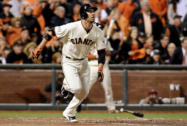 SAN FRANCISCO, CA - OCTOBER 16:  Travis Ishikawa #45 of the San Francisco Giants hits a three-run walk-off home run to defeat the St. Louis Cardinals 6-3 during Game Five of the National League Championship Series at AT&T Park on October 16, 2014 in San Francisco, California.  (Photo by Thearon W. Henderson/Getty Images) ORG XMIT: 517497343 Photo: Thearon W. Henderson / 2014 Getty Images