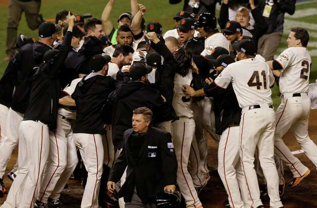 SAN FRANCISCO, CA - OCTOBER 16:  The San Francisco Giants celebrate after defeating the St. Louis Cardinals 6-3 during Game Five of the National League Championship Series at AT&T Park on October 16, 2014 in San Francisco, California.  (Photo by Jason O. Watson/Getty Images) ORG XMIT: 517497343 Photo: Jason O. Watson / 2014 Getty Images