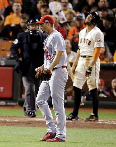 St. Louis Cardinals starting pitcher Adam Wainwright walks to the dugout after striking out San Francisco Giants' Hunter Pence during the sixth inning of Game 5 of the National League baseball championship series Thursday, Oct. 16, 2014, in San Francisco. (AP Photo/Jeff Chiu)  ORG XMIT: NLCS174 Photo: Jeff Chiu / AP