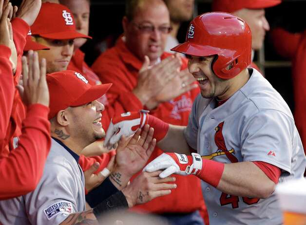 St. Louis Cardinals' Tony Cruz celebrates with Yadier Molina after Cruz hit a home run during the fourth inning of Game 5 of the National League baseball championship series against the San Francisco Giants Thursday, Oct. 16, 2014, in San Francisco. (AP Photo/David J. Phillip)  ORG XMIT: NLCS173 Photo: David J. Phillip / AP