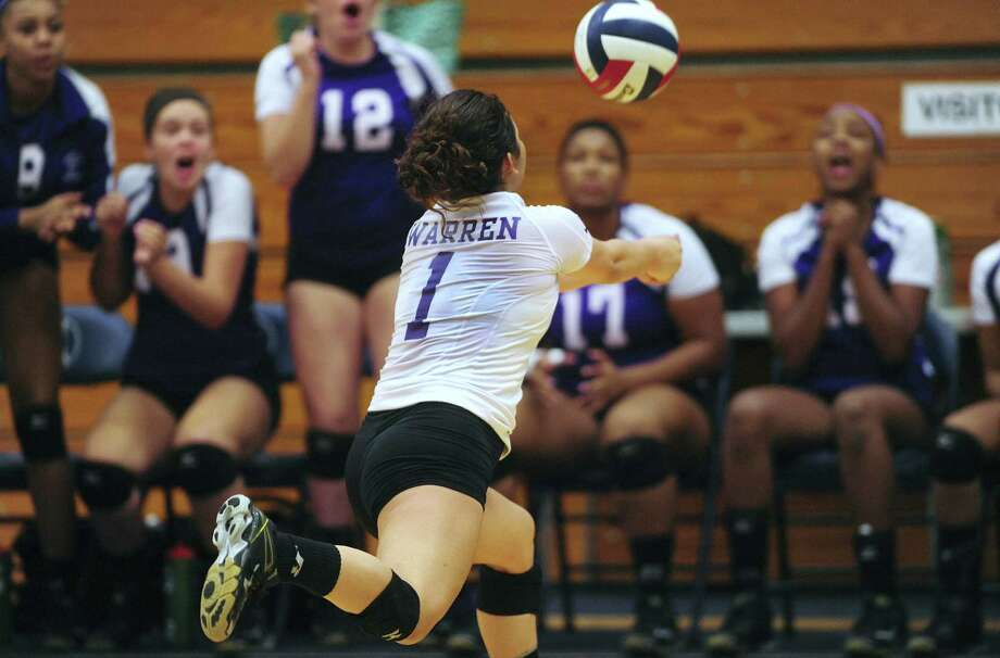 Lauren Jarrell of Warren lunges for the ball during a 27-6A match against O'Connor on Sept. 3. The Warriors are in the mix to earn one of the district's three remaining postseason berths. Photo: Billy Cazada / San Antonio Express-News / San Antonio Express-News