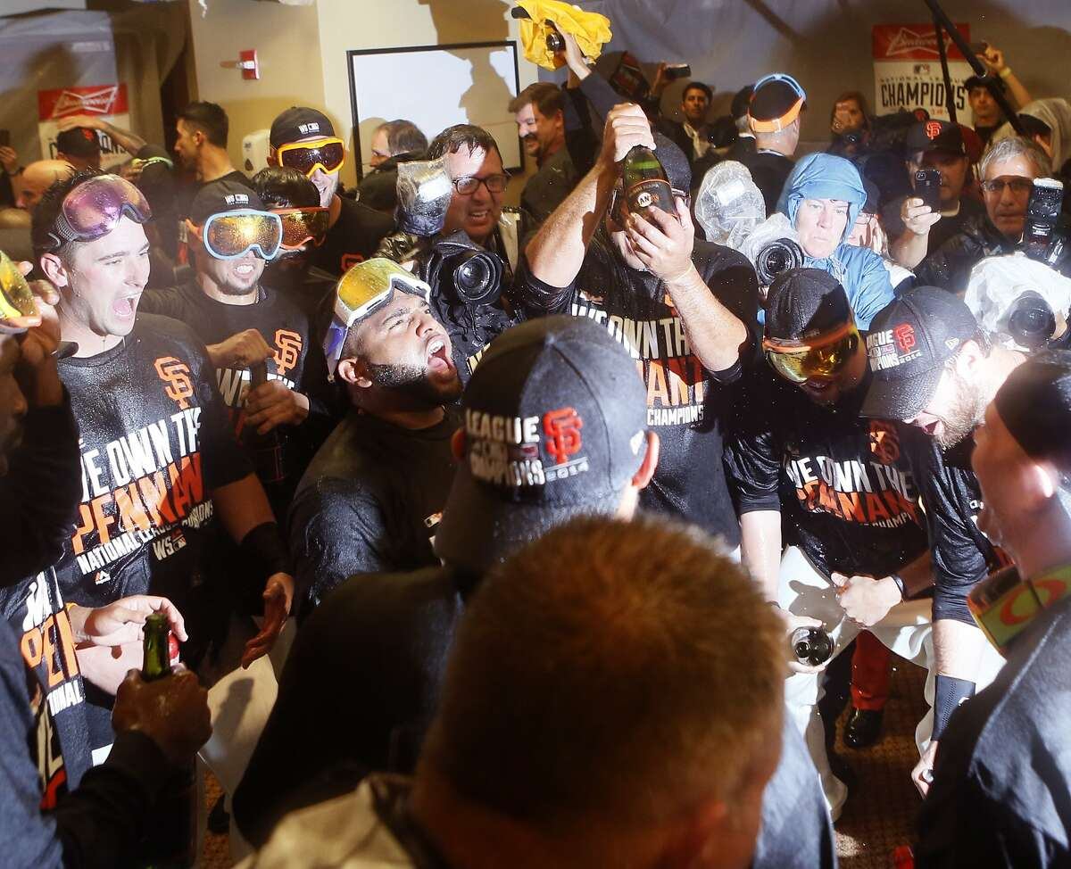 The Giants celebrate their win over the St. Louis Cardinals after Game 5 of the NLCS at AT&T Park on Thursday, Oct. 16, 2014 in San Francisco, Calif.