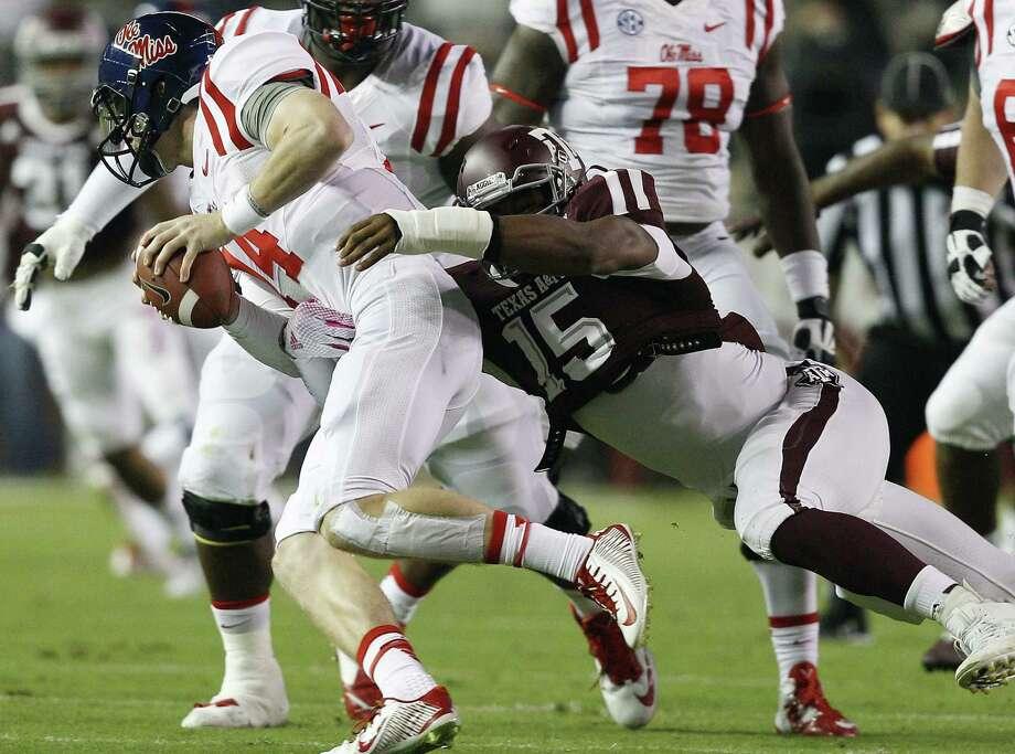 A&M freshman Myles Garrett (right) already has 7½ sacks, ½ shy of the SEC freshman mark set by Jadeveon Clowney. Photo: Bob Levey / Associated Press / FR156786 AP