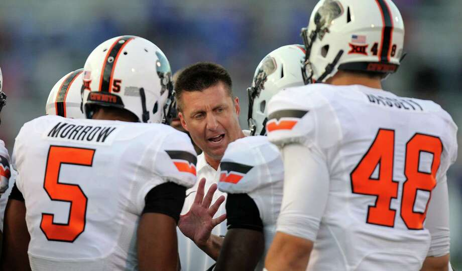 Despite a 5-1 record and No. 15 national ranking, Oklahoma St. coach Mike Gundy says his team isn't a Big 12 contender — yet. Photo: Ed Zurga / Getty Images / 2014 Getty Images