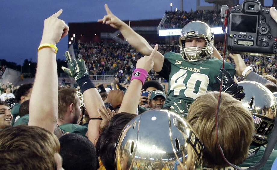 Baylor place-kicker Chris Callahan is lifted up by his teammates after his field goal as time expired pushed the Bears past TCU and kept them undefeated. Photo: Rod Aydelotte / Waco Tribune-Herald / The Waco Tribune-Herald