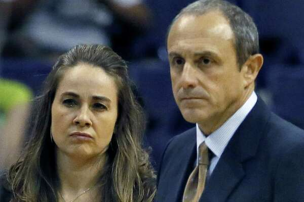 Spurs assistant coach Ettore Messina (right), who took Gregg Popovich's place Thursday, and assistant Becky Hammon discuss a play during the first half against the Suns.