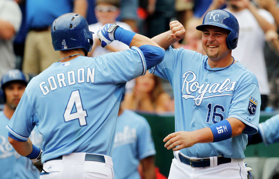 Kansas City Royals' Alex Gordon (4) is congratulated by teammate Billy Butler (16) after hitting a two-run home run in the first inning of a baseball game against the San Francisco Giants at Kauffman Stadium in Kansas City, Mo., Sunday, Aug. 10, 2014. (AP Photo/Colin E. Braley) Photo: Colin E. Braley / ASSOCIATED PRESS / ONLINE_CHECK