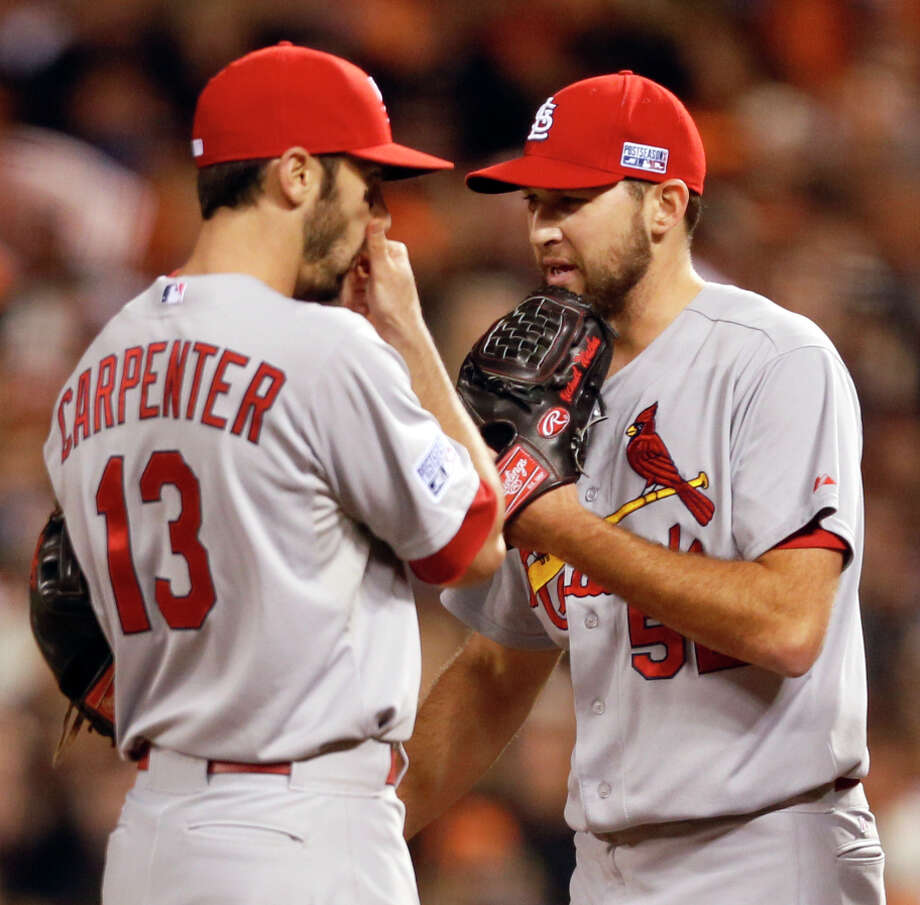 Cardinals Michael Wacha (right) and Matt Carpenter talk on the mound in the ninth inning during Game 5 of the NLCS. Photo: Beck Diefenbach / Special To The Chronicle / ONLINE_YES