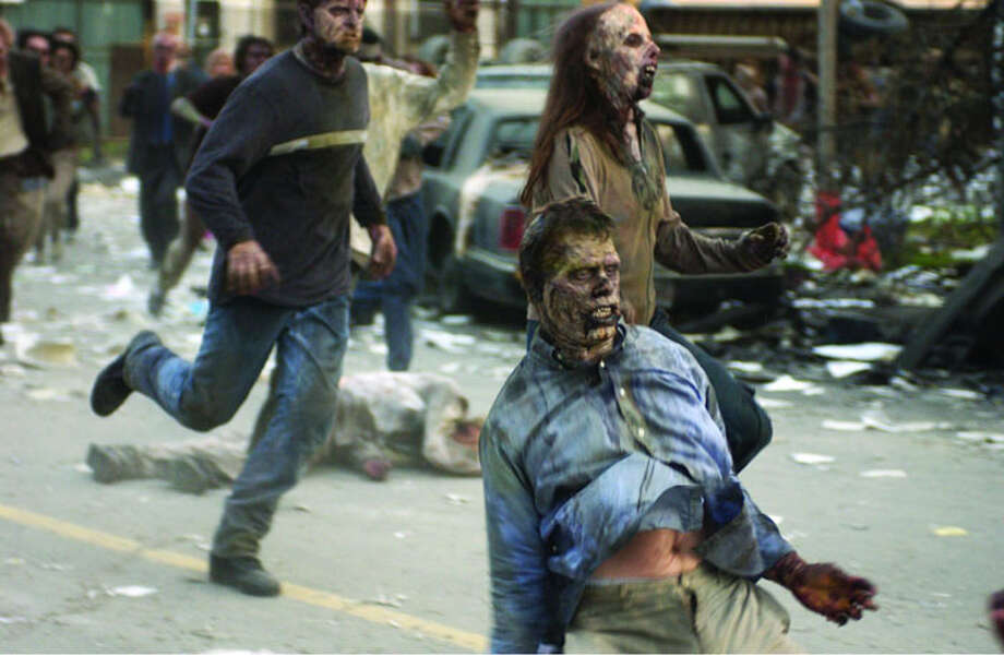 Dawn of the Dead 2004 In this remake of George Romero's 1978 movie of the same name, the zombie apocalypse is more of a disease outbreak. In the original, what the zombies are is not as important as Romero's social commentary on mass consumerism. Photo: Universal Pictures 2004 / Chronicle