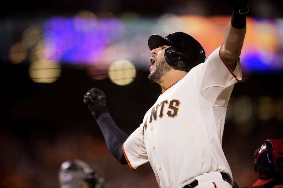 San Francisco Giants pinch-hitter Michael Morse reacts after hitting a home run in the eighth inning against the St. Louis Cardinals in Game 5 of baseball's NL Championship Series, Thursday, Oct. 16, 2014, in San Francisco. The Giants won 6-3 and advanced to the World Series against the Kansas City Royals. (AP Photo/The Sacramento Bee, Paul Kitagaki Jr.) Photo: Paul Kitagaki Jr. / Associated Press / The Sacramento Bee