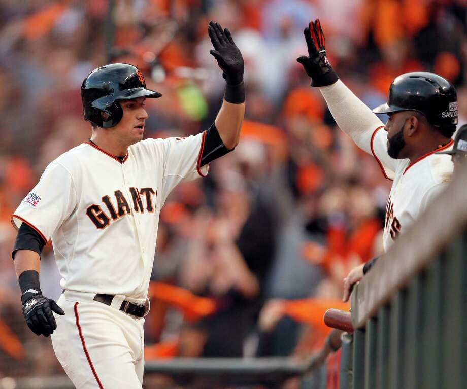 Giants Joe Panik is greeted by Pablo Sandoval after hitting two-run homer in the third inning during Game 5 of the NLCS at AT&T Park on Thursday, Oct. 16, 2014 in San Francisco, Calif. Photo: Beck Diefenbach / Special To The Chronicle / ONLINE_YES