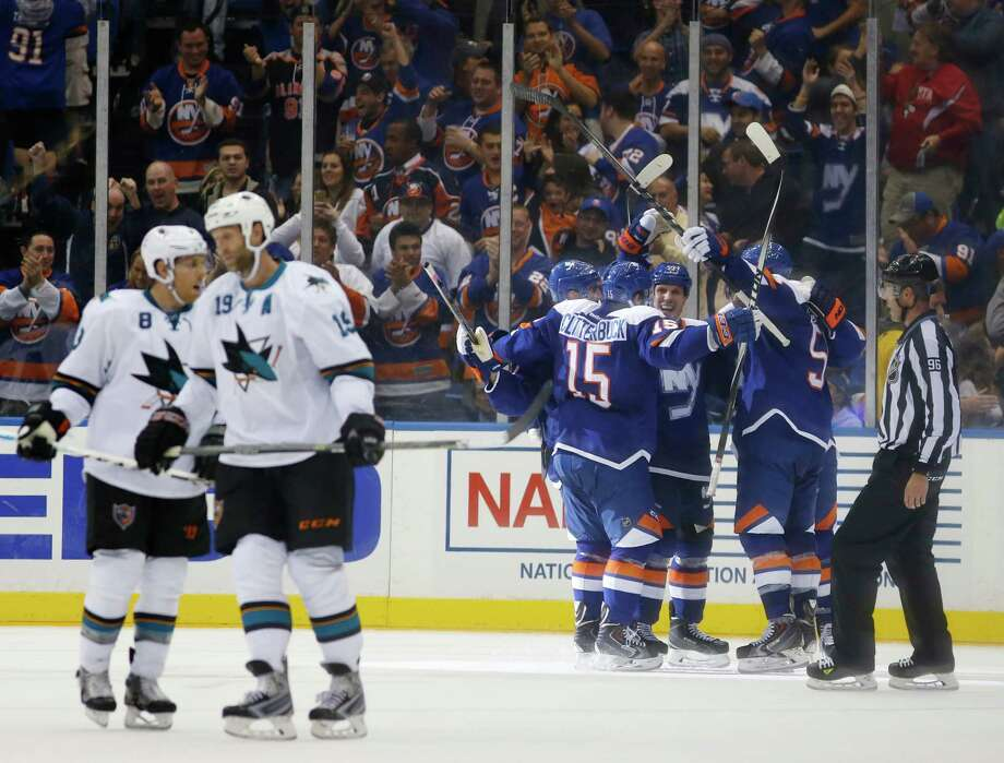 The New York Islanders celebrate Josh Bailey's third-period goal during an NHL hockey game against the San Jose Sharks in Uniondale, N.Y., Thursday, Oct. 16, 2014. The Islanders defeated the Sharks 4-3. (AP Photo/Kathy Willens) Photo: Kathy Willens / Associated Press / AP