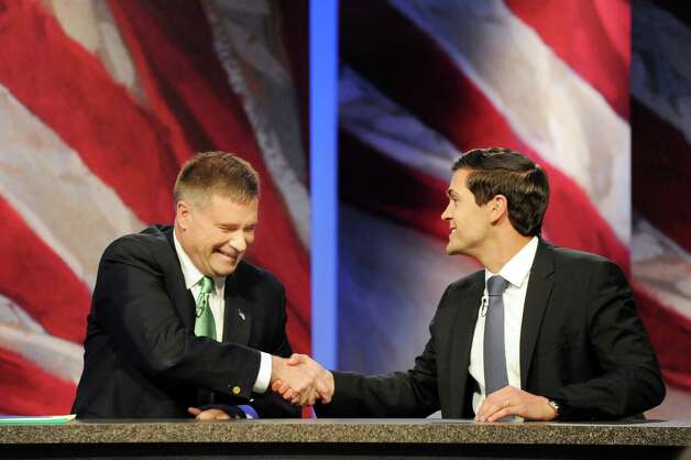 The 19th Congressional District candidates Rep. Chris Gibson, left, and Sean Eldridge shake hands at the conclusion of the debate on Thursday, Oct. 16, 2014, at WMHT Studios in North Greenbush, N.Y. (Cindy Schultz / Times Union) Photo: Cindy Schultz / 10028932A