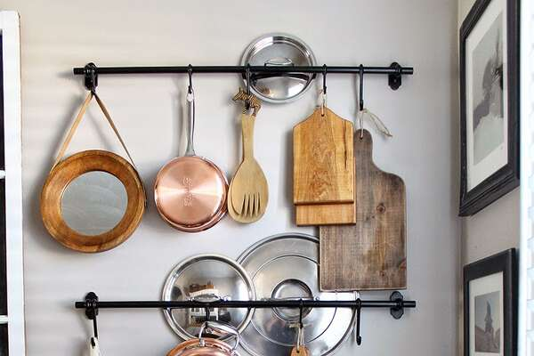 Store Awkward Objects A collection of kitchen tools is rarely uniform in size and shape, which can make organizing a challenge. Hang a long towel bar to store pesky pot lids and other hangable items well within reach. See more at Hammers & High Heels » Kitchen Gadgets That Improve Your Health9 Lies You Tell Yourself About Cleaning Your House11 Sneaky Storage Tricks For A Tiny KitchenAdd These Superfoods To Your Grocery List9 Charming Items Every Book Lover Needs17 Ways You're Sleeping Wrong