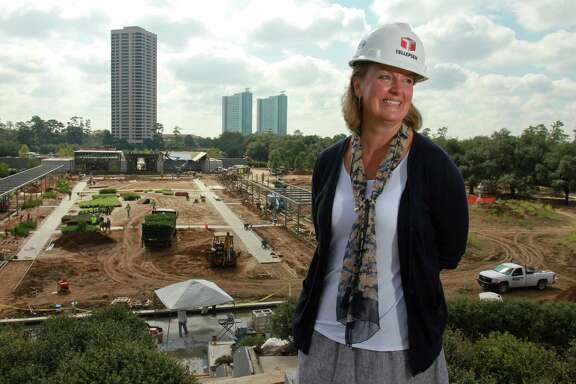 JaneCurtis, Director of Horticulture for McGovern Centennial Gardens in Hermann Park. In the background is a view of gardens from Garden Mount. (For the Chronicle/Gary Fountain, September 29, 2014)