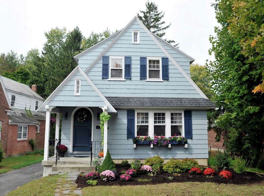 A view of the home at in Troy, N.Y. on Monday, Sept. 29, 2014.  The home owners had aluminum siding removed, and carpenters repaired missing details and replaced shingles.  The house was painted and shutters reinstalled.  (Paul Buckowski / Times Union) Photo: Paul Buckowski / 10028791A