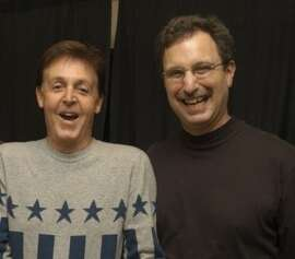 Dennis Constantine (right, in 2003 with Paul McCartney) is the director of broadcasting of Live 365.