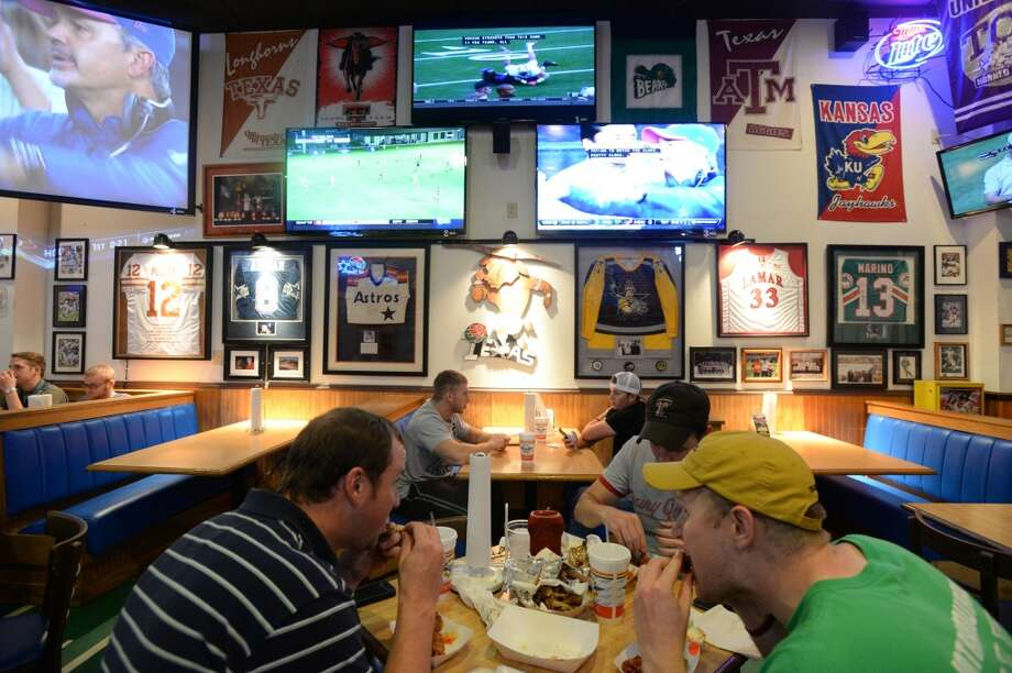 Wings To Go on Dowlen Road in Beaumont offers sports enthusiasts favorites, including major league sports coverage, beer and wings. It is among the many bar and grill establishments catering to sports fans. Photo taken Thursday, October 9, 2014 Kim Brent/@kimbpix