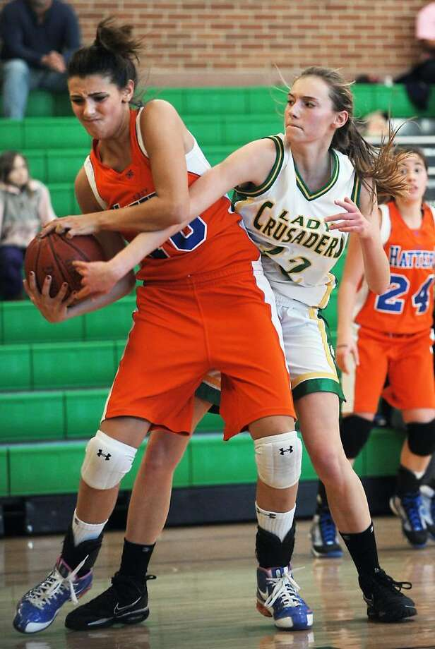 Trinity Catholic's Cayleigh Griffin battles for control of the ball with Danbury's Casey Smith in the quarterfinals of the FCIAC girls basketball championship in Stamford, Conn. on Saturday, Feb. 20,  2010. Photo: Kathleen O'Rourke / Stamford Advocate