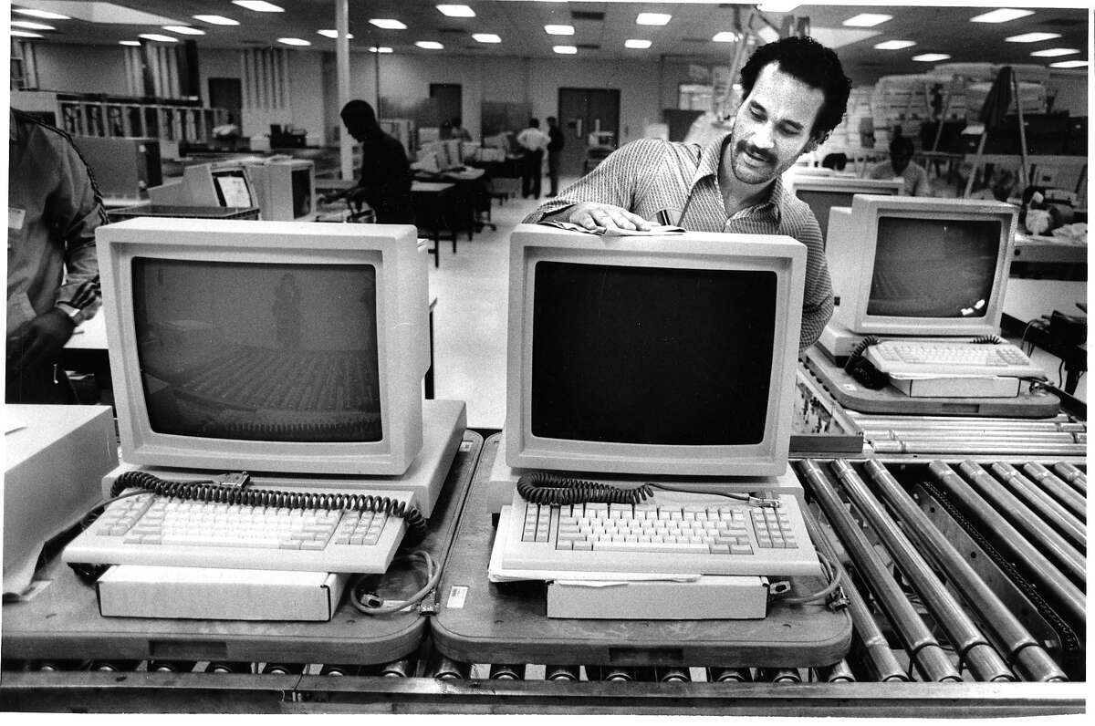 Click through this slideshow to see a look at Silicon Valley's history. In the early days of Sun Microsystems, employee Mark Hillard prepares a work station at the company's Mountain View headquarters in October 1986.