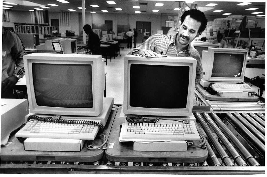 In the early days of Sun Microsystems, employee Mark Hillard prepares a work station at the company's Mountain View headquarters in October 1986.