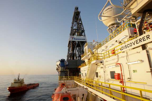 A supply vessel is shown next to the Discoverer Inspiration on Tuesday, March 30, 2010. Chevron is drilling an exploration well into Moccasin Prospect on Transocean's Discoverer Inspiration, an ultra-deepwater drillship, located about 240 nautical miles from Leesville, Louisiana in the U.S. Gulf of Mexico. The vessel has the capability to drill wells in 12,000 feet of water to a total depth of 40,000 feet.  ( Melissa Phillip / Chronicle )